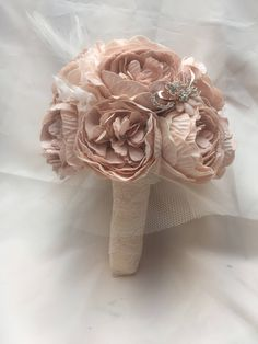 A personal favourite from my Etsy shop https://www.etsy.com/uk/listing/521400520/vintage-pink-rose-gold-foam-peony-bridal