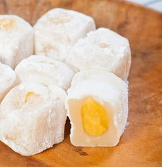 Mango Filled Mochi Mango flavored mochi filled with fresh mango!  Get this recipe at the following link:  http://cookinghawaiianstyle.com/index.php/component/recipe/recipes/detail/2882/mango-filled-mochi