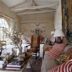 A vast double-height barn adjoins the house and has been furnished as a second living room