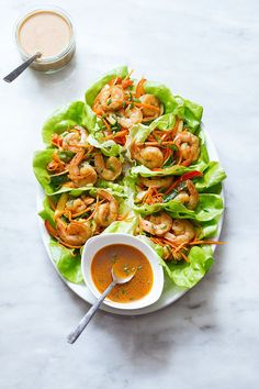 Shrimp Lettuce Wraps So tasty and easy to whip up for a quick lunch or a casual dinner! These shrimp lettuce wraps pack a flawless combination of flavors and textures: grilled shrimp with sautéed red peppers, carrots, … Shrimp Lettuce Wraps, Lettuce Wrap Recipes, Salad Recipes, Easy Lettuce Wraps, Healthy Eating Recipes, Clean Eating Snacks, Cooking Recipes, Healthy Foods, Healthy Baking