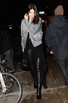 Kendall Jenner dined at Serafina in the Meatpacking District with Kim Kardashian wearing a floor-dusting sweater, silver bomber jacket, and slim leather pants (which she probably immediately regretted after catching sight of the restaurant's cheesesteak pizza with truffle sauce).