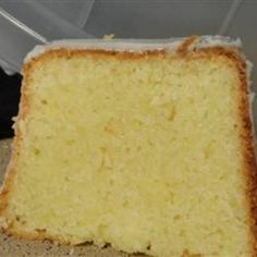 Buttermilk Pound Cake - Tangy, moist, and flavorful pound cake. Can be eaten plain or use as a base for numerous dessert ideas,,