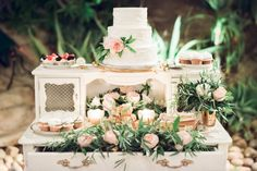 Vintage dessert table drenched in flowers