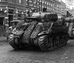 Image at War Thunder Communities Center A British M4A4 Sherman tanks, with improvised tank track 'armour' seen during the liberation of Arnhem, Holland, on April 1945.
