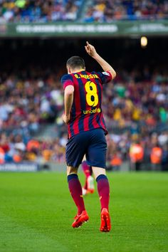 Andres Iniesta of FC Barcelona points his finger to the sky after scoring his team's third goal during the La Liga match between FC Barcelona and CA Osasuna at Camp Nou on March 2014 in Barcelona, Catalonia. Fc Barcelona, Barcelona Catalonia, Lionel Messi, Fifa, Xavi Iniesta, Ca Osasuna, Stoke City Fc, Plein Air, Champions League