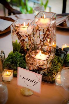 unity candle or centerpieces use fall tree branches in the water and fall leaves round the base. Floating Candle Centerpieces, Unity Candle, Hanging Candles, Centerpieces With Lights, Floating Candles Wedding, Romantic Candles, Centerpiece Ideas, Wedding Table, Fall Wedding