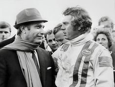 Five-time world champion driver and legend Juan Manuel Fangio meets actor/racer Steve McQueen during the filming of the movie Le Mans.