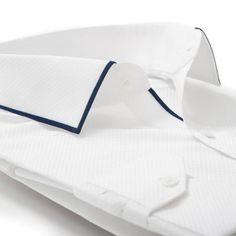 Men's dress shirt collar and hidden placket detail.