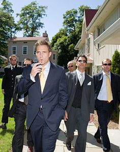 More navy blue suits with yellow ties
