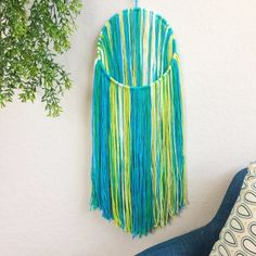 Bohemian Fiber Wall Hanging in BlueYellow // Inspired by the the Bright colors of Spring. BarnyardPeacock yarn wall hangings are the perfect pop of modern color and texture for your modern bohemian home.    Beautiful as a stand alone piece and also excellent at breaking up the straight lines of gallery walls, Bohemian Fiber Wall Hanging in BlueYellow will add softness and depth to your home. Perfect as Birthday, anniversary, Nursery, or housewarming presents, gift these bohemian inspired…