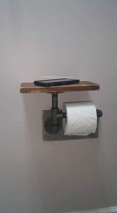 """Industrial Toilet Paper Holder, Farmhouse Toilet Paper Holder, Plumbing Pipe Toilet Paper Holder, Industrial Bathroom, Rustic - with Shelf - Constructed of ½"""" iron pipe made from unfinished fittings with a natural gunmetal color. Farmhouse Toilet Paper Holders, Bathroom Toilet Paper Holders, Toilet Paper Roll Holder, Industrial Toilet Paper Holders, Industrial Toilets, Industrial Pipe Shelves, Plumbing Pipe Shelves, Shelves With Pipes, Rustic Shelving"""