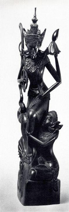 Vishnu rescuing the goddess of the Moon Devi Ratih. Bali, Indonesia. 20th century.Carved mahogany.