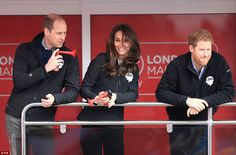 Supporting the runners: The royal trio used blowhorns to make some noise as the race kicke...