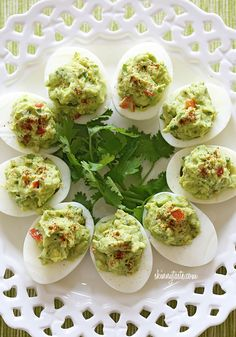 Guacamole Deviled Eggs | Skinnytaste    6 large eggs, hard boiled (recipe here)  1 medium haas avocado  2-3 tsp fresh lime juice  1 tsp red onion, minced  1 tbsp minced jalapeno  1 tbsp fresh cilantro, chopped  kosher salt and fresh ground pepper, to taste  1 tbsp diced tomato  pinch chile powder (for garnish)