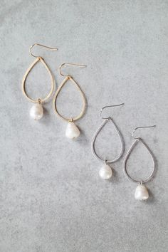 "One of our most popular styles is back! Add these beautiful teardrop earrings with freshwater pearls to your weekly-worn jewelry. Details: - 2.25"" drop - Handcrafted"