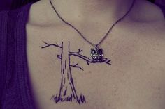 owl tattoo/neclace combo? wierd but interesting