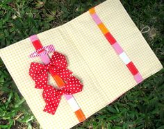 Booklet style hairbow holder.