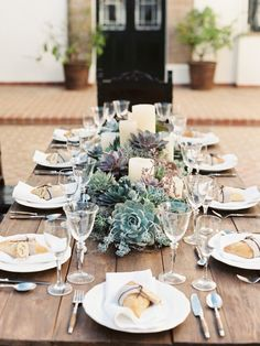 Or you can skip the planter box and instead line your tables with clusters of succulents crowded around thick pillar candles.  Lovely for a rustic wedding with tables you don't wish to cover in linens, this is a relatively affordable tablescape.