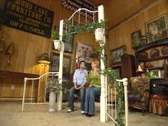 Garden arbor made from a daybed frame and posts