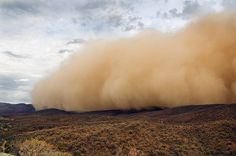A massive dust storm wills over the Arkaroola Wilderness Sanctuary in the northern Flinders Ranges of South Australia. Photo: Peter MacDonald