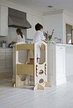 Best way for your kids to help you in the kitchen? The Learning Tower!  #LearningTower #WoodenToys #LittlePartners #KidsCook #Parenting