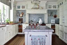 Oooh, white with blue tiles in the kitchen.