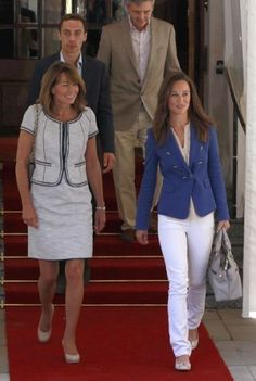 Middleton family leave the Goring Hotel the day after.  Pippa knows how to rock white pants.