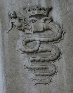 ppff:    Coat of Arms of the Visconti  of Milan depicting the biscione, a serpent who appears to be swallowing a  human, but is actually giving birth to it.