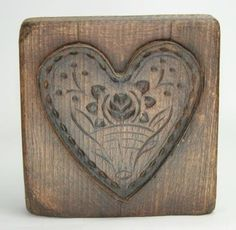 19th C Mid Atlantic origin cookie board. Nicely carved basket with flowers and vines surrounded by tin heart mold.