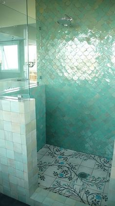 Wow, so beautiful! Love the wall tiles in the shower. They remind me of a mermaid's tail! I love everything about this shower. If a seat was added, it'd be even better! :)