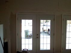 this is what we are doing. French doors in place of a garage door. Very good tips. <3
