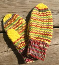 These are hand knit mittens. The toddler mittens are knit on four needles instead of two like most, making them seamless and comfortable. Traditionally knit mittens are knit on two needles and then sewn with a seem and the thumbs are both the same and only ironed over. These are actually knit as a right and a left with opposing thumbs and have no seam. These mittens are knit with a soft acrylic yarn in yellow and green multi color. They are ideal fro small outings and shopping trips.  These m... Knit Mittens, Knitted Hats, Toddler Mittens, Hand Knitting, Trips, Sewing, Yellow, Green, Shopping