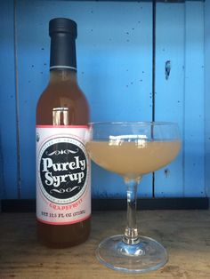 The Royal Navy  2 oz. Gin (preferably Plymouth) 1 oz. fresh grapefruit juice 1 oz. Purely Syrup Grapefruit  4 dashes Rhubarb Bitters  Combine all ingredients into mixing tin and shake for approximately 8-10 seconds. Strain into a chilled coupe and garnish with a grapefruit skin.