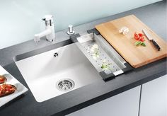 White undercount sink option may work better with white worktop than metal.