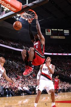LeBron James #6 of the Miami Heat drives to the basket and dunks the ball hard