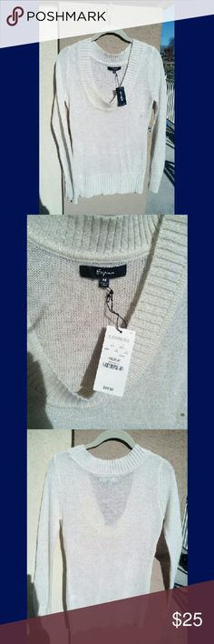 NWT $49 Express shimmery vneck sweater gold white In new condition with original tags from Express! Original price was $49.50. Size medium. A sophisticated off white with golden shimmery threads in the sunlight. Has scrunched waist, cuffs and neckline. Would make a great gift. Express Sweaters V-Necks