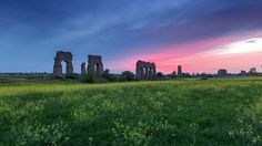 Ancient Roman aqueduct - In the park of aqueducts in Rome, it stands the old Claudian aqueduct that once carried drinking water throughout the city of Rome. Roman Ancient Aqueduct Aqueduct Segovia Archeaology Landscape Panorama Rural Scene