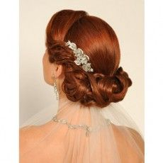 twisted curly bridal updo hairstyle with diamante clip