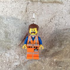 Oh, my G.O.S.H!  Great for in the Christmas sock!  Emmet hangs on a 46cm silver plated ball chain necklace and is nickel/lead free.  More Lego mini figure necklaces available at gagabricks.etsy.com