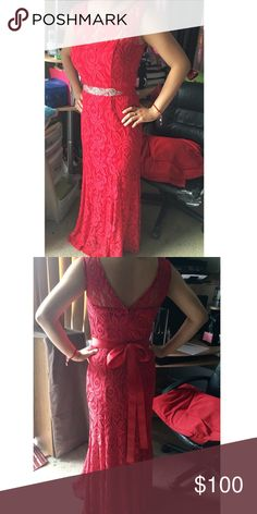 Red lace prom dress.! 😍❤️ Red Lacey prom dress, two slit on the front with lace over them, and an embellished belt around back is semi open as sen on the pictures. I'll take any offers on it, just leave me a comment on how much and I'll get back to you.! Dresses Prom