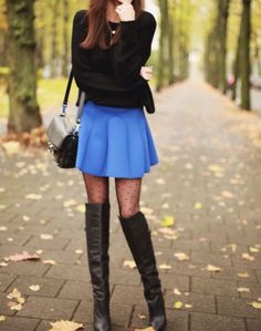 Polka dot tights paired with tall boots