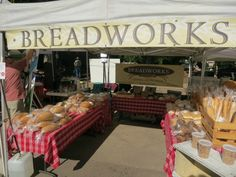 Breadworks boulder is one of many tents at the farmers market on a Saturday morning.
