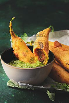 JODHPURI MIRCHI VADA ~~~ jodhpuri mirchi vada aka rajasthani mirchi vada are battered deep-fried green peppers stuffed with spicy potato filling. recipe gateway: this post's link + http://www.vegrecipesofindia.com/mirchi-vada-recipe-rajasthani-mirchi-vada/ [Rajasthani Cuisine] [cubesnjuliennes]