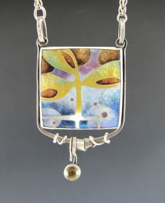 Anna Carlton Enamels. Cloisonne enamel set in sterling silver, accented with citrine; handmade chain.