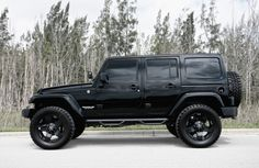 Blacked out Jeep Wrangler by Exclusive Motoring........someday.......maybe not, but I can dream!