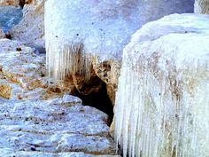 Frozen rocks on the breakwall in Lexington Harbor, Michigan.