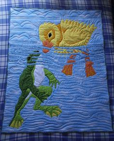 Sew Fresh Quilts. Wonderful pictorial quilt. I love the way the blue strips of water go over the duck and frog to give some depth. The quilting is amazing with a mix of water and sky.