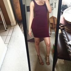 """Wine and Dine"" bodycon dress Gorgeous wine color  worn around the house and one time out I believe. In great condition. I am 5'1 modeling this. Dresses Mini"