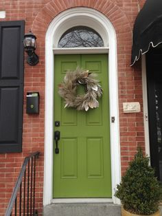 Brick, black shutters and green door.still like this color combo. by delia black shutters and green door.still like this color combo. by delia Front Door Paint Colors, Painted Front Doors, House Front Door, House Doors, Front Porch, Orange Brick Houses, Red Bricks, Orange Front Doors, Green Doors