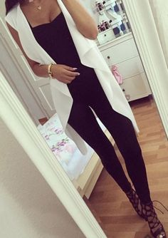 All black outfit with white vest